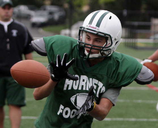David Le/Gloucester Daily Times. Manchester-Essex senior wide receiver Joe Burgess, hauls in a reception at practice on Thursday afternoon. 8/25/11.