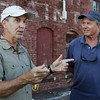 David Le/Gloucester Daily Times. Iain Kerr, left, talks with Dick Perkins, right, of Gloucester, about the work being done to rebuild the Paint Factory on Wednesday evening. 8/17/11.