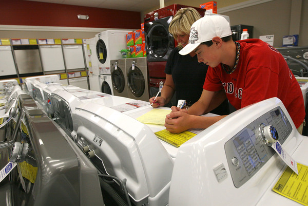 Julie Ryan and her son, Stephen, look at washers and dryers at Sears in advance of the tax free weekend, which is this weekend. Their appliances recently broke, so the extra savings is coming at a good time for them. Photo by Kate Glass/Gloucester Daily Times