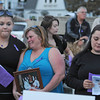 Gloucester:  Lourie Paterno reacts with pain as she hears her son Michaels name being read during a candle light vigil ceremony  remembering those who died from heroin last night on the Boulevard. Her son Michael Rogers,passed away last year,came together with her daughter Roseanne El Amine (right) and friend Kayla Brancaleone who Roseann called, Michaels Guardian Angel. Desi Smith /Gloucester Daily Times. August 31,2011
