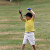 Ryan Borge, 6, raises his arms after hitting a ball into the net during the Bass Rocks Junior Clinic at the Bass Rocks Golf Club yesterday morning.  Photo by Kate Glass/Gloucester Daily Times