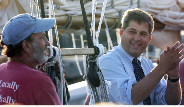 Senator Bruce Tarr celebrates the arrival of the locally built scooner Ardelle, with the ship builder, Harold Burnham at the Maritime Gloucester. Photo by Maria Uminski/Gloucester Daily Times