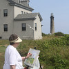 Virginia Hill of Danvers paints a scene of the keepers house and north tower on Thacher Island as part of the Thacher Island Association's Art and Photo Days. Pieces created on these days will be part of a show and sale at the Rockport Community House September 1-5. Photo by Kate Glass/Gloucester Daily Times
