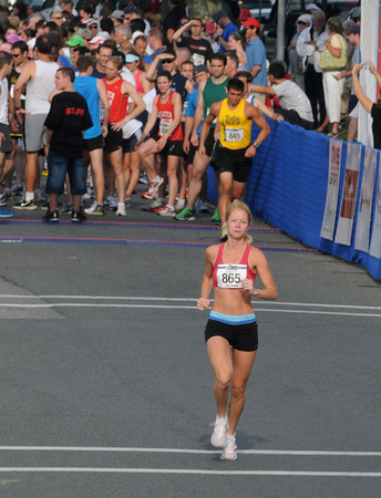Gloucester:  Laci Alves warms up before the Run Gloucester 7 mile on Sunday August 21,2011. Laci finished third. Desi Smith /Gloucester Daily Times. August 21,2011