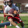 David Le/Gloucester Daily Times. Gloucester High School football player Zach Smith participates in a cutting drill during the first afternoon of practice for the 2011 season. 8/22/11.