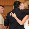 David Le/Gloucester Daily Times. Gloucester High School sophmore Hannah Ellis hugs John John Nicastro after being recognized as a JJ Nicastro Scholarship recipient at the Gloucester House on Wednesday evening, as David Nicastro, smiles and looks on. 8/17/11.