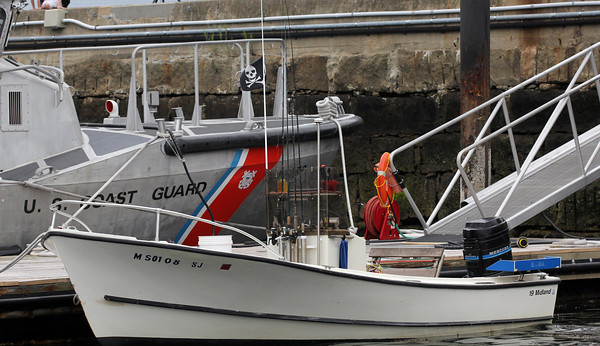 Two men from Gloucester and Ipswich who were aboard this boat outfitted with a pirate flag were arrested and charged with attempting to rob another boat in Smith's cove Thursday night. Photo by Kate Glass/Gloucester Daily Times