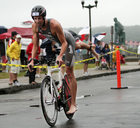 David Le/Gloucester Daily Times. Ethan Brown, who eventually won the Gloucester Fisherman Triathlon, cruises down Western Ave. towards the finish of the bike race and beginning of the foot race towards the finish line on Sunday morning. 8/7/11.