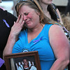 Gloucester:  Lourie Paterno reacts with pain as she hears her son Michaels name being read during a candle light vigil ceremony  remembering those who died from heroin last night on the Boulevard. Her son Michael Rogers passed away last year. Desi Smith /Gloucester Daily Times. August 31,2011