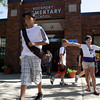 Rockport Elementary student Jason Mahoney leaves school and heads for the bus after finishing up his first day of the new school year on Tuesday. David Le/Gloucester Daily Times