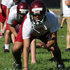 David Le/Gloucester Daily Times. Gloucester High School lineman Daniel Gonzales practices proper blocking technique on the first day of practice on Monday afternoon. 8/22/11.