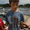 Justin Daniels, 13, checks out two crabs he caught at Tuck's Point on Wednesday using mussels for bait. Photo by Kate Glass/Gloucester Daily Times