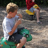 Brothers Chase and Charlie Davis, 8 and 9, of Manchester sit on playground animals at Masconomo Park while they enjoy their ice cream after a day at Tucks Point. Photo by Maria Uminski/Gloucester Daily Times