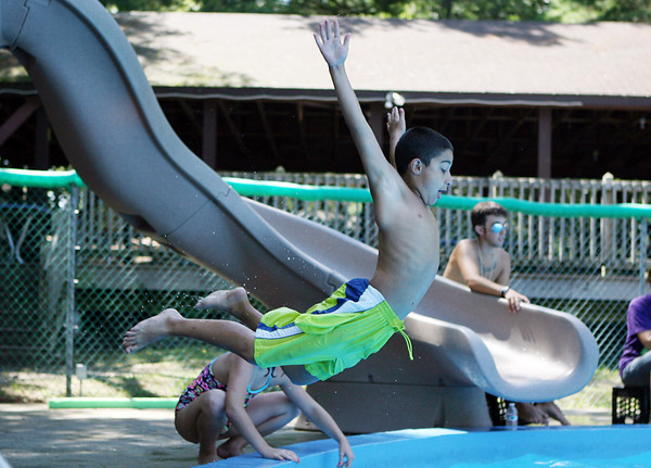 David Le/Gloucester Daily Times. AJ Romeo-Oliver, 11, takes a flying leap into the pool to cool off on a hot August afternoon at the Cape Ann YMCA. 8/19/11.