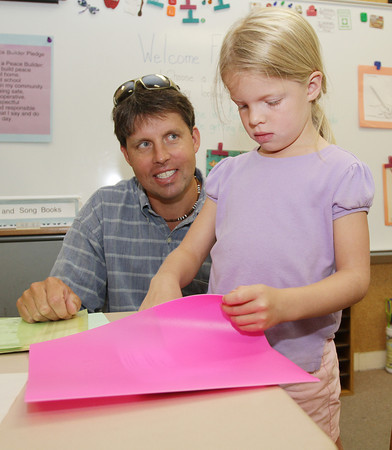 Ella Lorenz, 6, of Rockport, looks through a new folder she found in her desk while her father Mark Lorenz, looks on. David Le/Gloucester Daily Times.