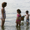 David Le/Gloucester Daily Times. Mia Rosenblatt-Tinkjian, of Newton, left, stands with her daughter Rose, 7, and her nephew Leo Rose-Levin, 4, in the water at Plum Cove Beach on Thursday afternoon. 8/18/11.