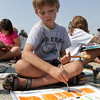 David Le/Gloucester Daily Times. Nathan McWilliams, 9, of Rockport puts some detail into his artwork during a painting class run by the Rockport Art Association at T-Wharf.
