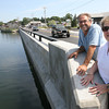 Bob Coviello and Sue Lufkin of Essex stand at the site of a proposed boardwalk, which would run along the Causeway and provide additional space for boaters visiting businesses downtown. Photo by Kate Glass/Gloucester Daily Times
