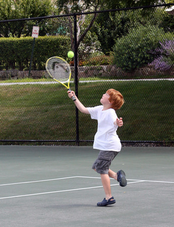 Sean Vendt, 7 of Manchester, plays a game of tennis with his dad Eric Vendt at the Coach Ed Field Playground. Photo by Maria Uminski/Gloucester Daily Times.