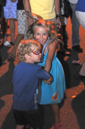 Gloucester: Madison Mosely 5,of Rockport dances with her brother Travis 3, while dancing to live music on Main St at the Annual Block Party Saturday night.   Desi Smith /Gloucester Daily Times. August 20,2011