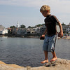 Riley Blanchard, 5, of Rockport, searches for loose rocks as he scales the large rocks at Back Beach. Photo by Maria Uminski/Gloucester Daily Times