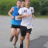 Gloucester: Nick Desouza of Salem,Ma holds a slight lead at mile 5 on Atlantic Rd over Jacob Barnett of Medford,Ma and Alex White of Summerville,Ma in the 2nd Annual Run Gloucester 7 mile Sunday morning. Barnett edges Desouza out at the finish by 6 seconds. Desi Smith /Gloucester Daily Times. August 21,2011