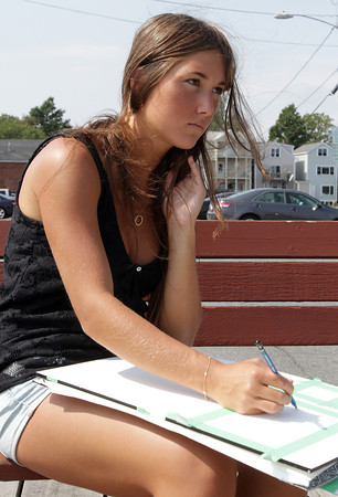 David Le/Gloucester Daily Times. Gen Aboud, a student at McGill University in Montreal, sits on a bench on T-Wharf, while she sketches the Rockport scenery