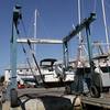 David Le/Gloucester Daily Times. A speedboat is hoisted out of the water by Crocker's Boat Yard in Manchester on Friday afternoon. Many boats were being pulled from the water so they would not be damaged by the possible hurricane. 8/26/11.