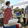 Niaz Dorry of the Northwest Atlantic Marine Alliance unveils the surprise ingredient, skate wings, as emcee Peter van Ness provides commentary during the Seafood Throwdown at the Cape Ann Farmer's Market yesterday. Photo by Kate Glass/Gloucester Daily Times