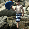 David Le/Gloucester Daily Times. Leo Rose-Levin, 4, prepares to go swimming with his styrofoam board at Plum Cove Beach on Thursday afternoon. 8/18/11.
