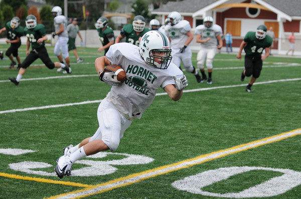 Manchester: A Manchester player runs for extra yards after catching a pass during a scrimmage game Saturday morning against Pentucket at MERHS. Desi Smith /Gloucester Daily Times. August 28,2011.