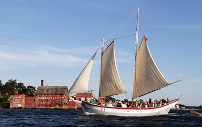 David Le/Gloucester Daily Times. The Schooner Ardelle sails past the Old Paint Factory on its way to Maritime Gloucester on Wednesday evening. 8/24/11.