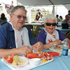Rockport: Rockport residents Jerry and Judy Skeen dig into their lobster dinner at Lobster Fest Saturday afternoon.  Desi Smith/Gloucester Daily Times. August 13, 2011