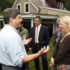 David Le/Gloucester Daily Times. Stephanie East, right, a single mother of two children, is the owner of the 10,000th House being weatherized under the American Recovery and Reinvestment Act, and talks with State Senator Bruce Tarr, left, on Tuesday morning outside her home. 8/16/11.