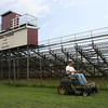 Ricky Gallant mows the lawn outside Newell Stadium yesterday. The city is seeking proposals for naming rights to the field with the minimum bid starting at $500,000. Photo by Kate Glass/Gloucester Daily Times
