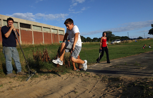 Rodney Nyborg, 10, sees how far he can jump during the Little Kiddies Track Program at O'Maley Middle School. The program runs Wednesday nights at 6pm and is sponsored by the Gloucester Parks and Recreation Department and Cambridge 7 Associates. Photo by Kate Glass/Gloucester Daily Times