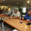 From right: Jeff Fletcher, Tim Knowles, John Pasierbiak, Ralph Hanibal Jr., Keith Killam, Sandra Kee, Sheryl Hansen and Jerry Olson fill the members lounge at the American Legion, which recently reopened for its members and guests. Photo by Kate Glass/Gloucester Daily Times