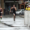 David Le/Gloucester Daily Times. Brian MacIlvain, right, kicks up water as he sprints past ______ in the final stretch of Main St. towards the finish line on Sunday morning. 8/7/11.