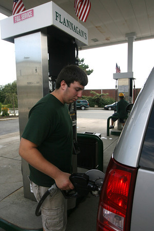 Jake Parisi pumps gas for a customer at Flannagan's yesterday. To save money on gas, it is recommended to avoid topping off the tank as the extra gas will just evaporate. Photo by Kate Glass/Gloucester Daily Times