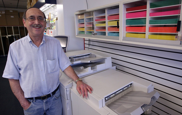 David Rome, owner of Easy Ship & Pack at the Cape Ann Marketplace, has survived the sluggish economy by catering to local needs of artists and summer residents in addition to regular shipping tasks. Photo by Kate Glass/Gloucester Daily Times