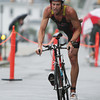 David Le/Gloucester Daily Times. _____________ glides down Western Ave. as he prepares to dismount from his bicycle and begin the running portion of the Gloucester Fisherman Triathlon on Sunday morning. 8/7/11.