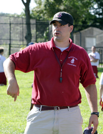 David Le/Gloucester Daily Times. New Gloucester head football coach Tony Zerilli, talks with one of his players at the teams' first practice on Monday. 8/22/11.