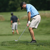 David Le/Gloucester Daily Times. Fred Forsgard hits a chip shot onto the green during the Bass Rocks Golf Tournament on Thursday afternoon. 8/18/11.