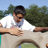 David Le/Gloucester Daily Times. Urian Touch, 14, of Lowell, scales the climbing wall at the Stage Fort Park playground on a warm Friday afternoon. 8/26/11.