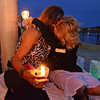 Gloucester:  Dawn Levie (left) gets a hug from organizer Diana Smith, during a candle light vigil ceremony remembering those who died from heroin last night on the Boulevard.  Desi Smith /Gloucester Daily Times. August 31,2011