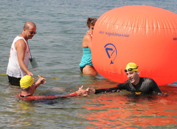 Gloucester:  Men's first place finisher Ethan Saulnier congratulates second place finisher Joe Sheehan after as close finish in the Annual Clean Harbor Swim at Niles Beach Saturday morning. <br /> Desi Smith/Gloucester Daily Times. August 13,2011
