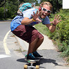 David Le/Gloucester Daily Times. Devin Mock, of Rockport, skates down Thatcher Road in Rockport on his way to the beach on Tuesday afternoon. 8/23/11.