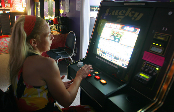 Tanaia Ventura plays the slots at Lucky 7's in Gloucester during the arcade's 5-year anniversary celebration. Photo by Maria Uminski/Gloucester Daily Times