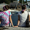 David Le/Gloucester Daily Times. Olivia Sargent, 15, left, and her sister Erin, right, of Tyngsborough, sit along an ocean wall at Bearskin Neck enjoying the view of Rockport Harbor on Wednesday afternoon. 8/17/11.