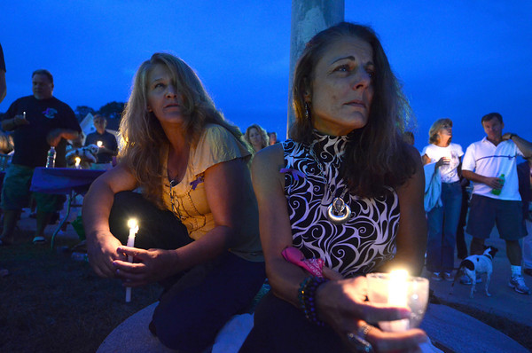Gloucester:  Nancy Peavey and Dawn Levie came to remember their loved ones, during a candle light vigil ceremony remembering those who died from heroin last night on the Boulevard.  Desi Smith /Gloucester Daily Times. August 31,2011
